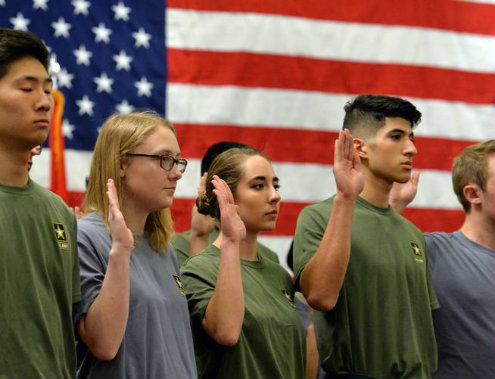 U.S. Army recruits are sworn in to service during the ceremony at the Best Western Plaza Hotel in Longmont. (David R. Jennings, Daily Camera)