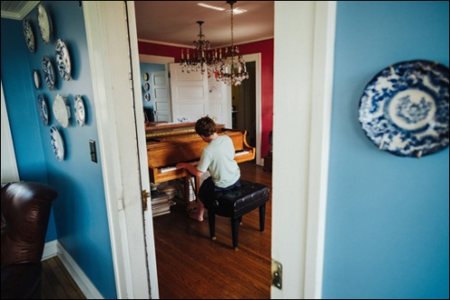paulius-z-at-piano-through-doorway-blogsize